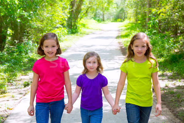 Friends and sister girls walking outdoor in forest track Stock photo © lunamarina