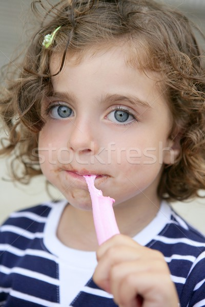 Little girl eating sweet candy with dirty face Stock photo © lunamarina