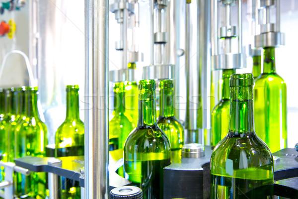 Stock photo: white wine in bottling machine at winery