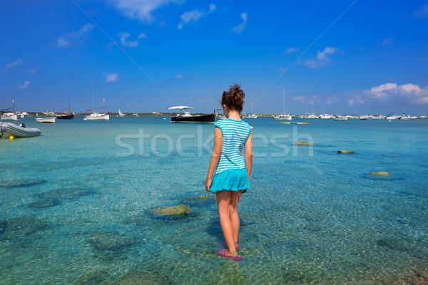 Kid girl walking at Formetera in Estany des Peix Stock photo © lunamarina