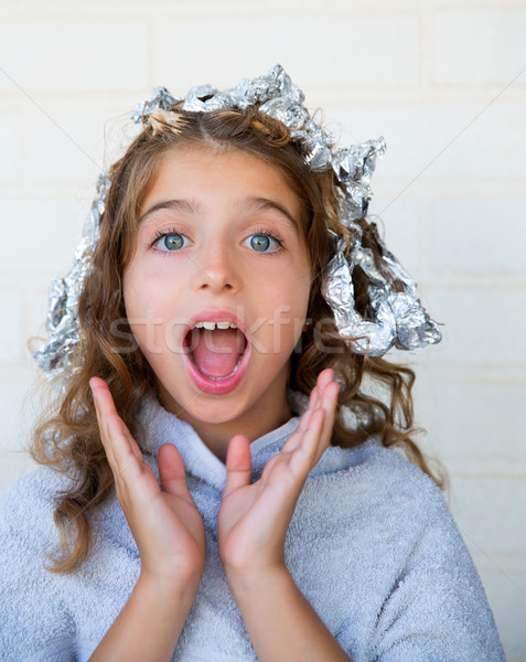Funny kid girl surprised with his dye hair with foil Stock photo © lunamarina