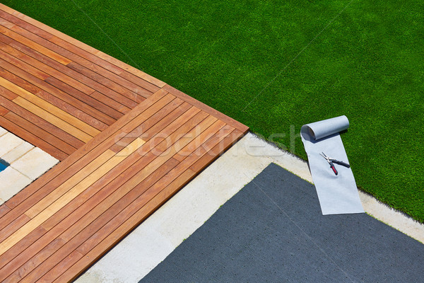 Artificial grass installation in deck garden with tools Stock photo © lunamarina