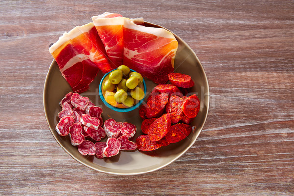 Tapas of Spain with ham olives sausage chorizo Stock photo © lunamarina