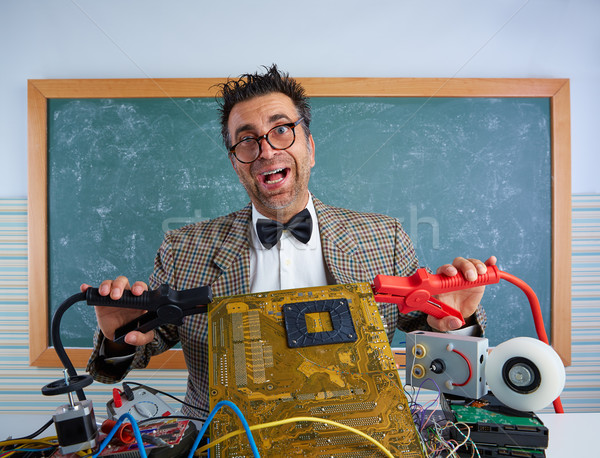 Nerd electronics technician retro silly expression Stock photo © lunamarina