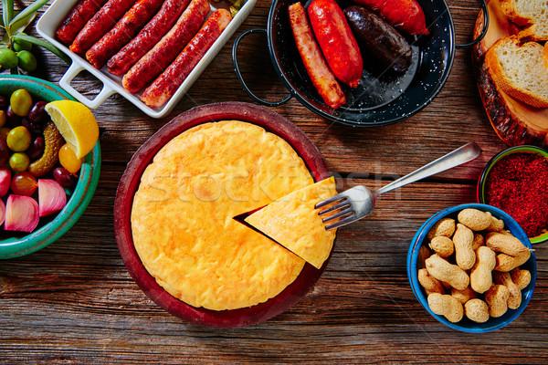 Tapas mix spanish potatoes omelette sausages Stock photo © lunamarina
