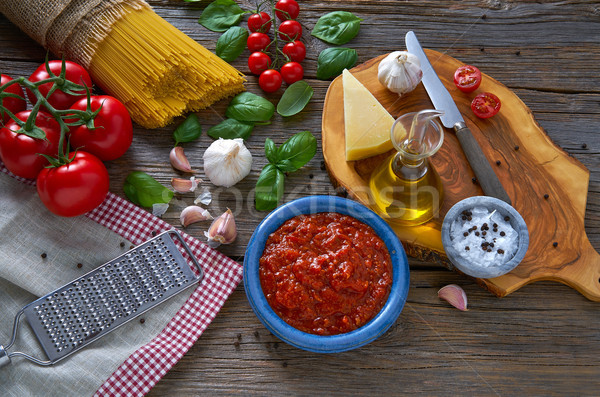 Italian Spaghetti pasta cheese tomato garlic basil Stock photo © lunamarina