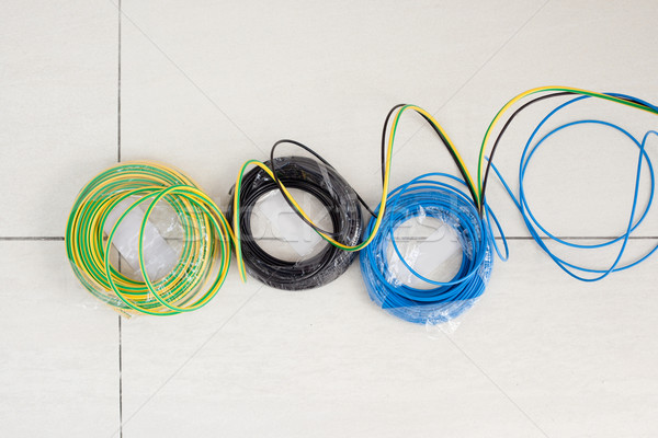 Electric cable coil in three colors black blue and earth Stock photo © lunamarina