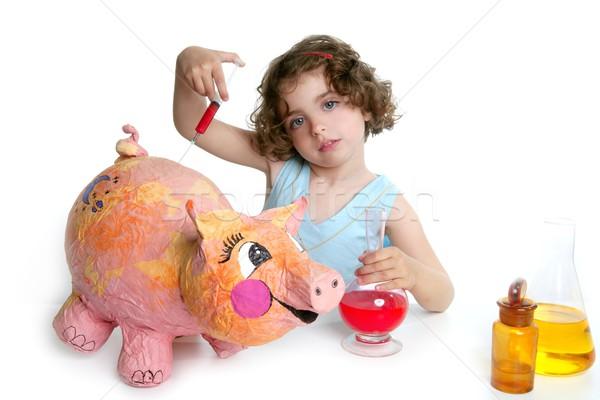 Little girl pretending be veterinary with a pig Stock photo © lunamarina
