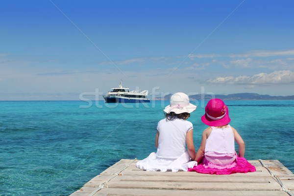 happy girl tourist turquoise sea back in Formentera Stock photo © lunamarina