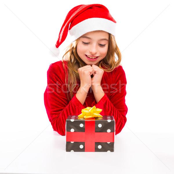 Christmas Santa kid girl happy excited with ribbon gift Stock photo © lunamarina