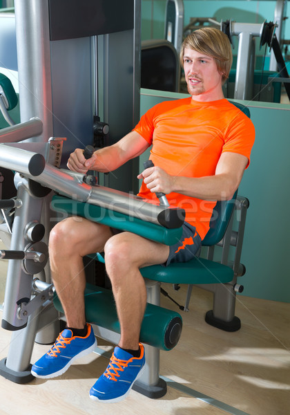 Gym seated leg curl machine exercise blond man Stock photo © lunamarina