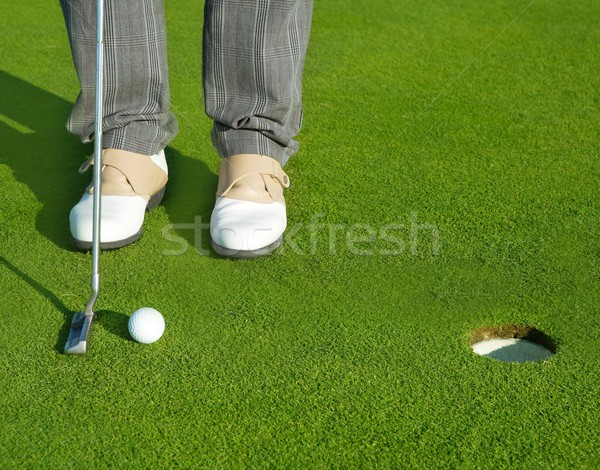 Stock photo: Golf green hole course man putting short ball