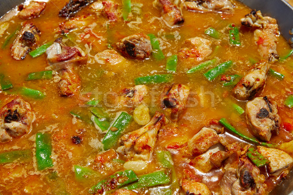 Paella from Spain recipe process ad water Stock photo © lunamarina