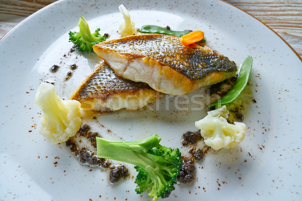 Seabass sea bass with stir fried vegetables Stock photo © lunamarina