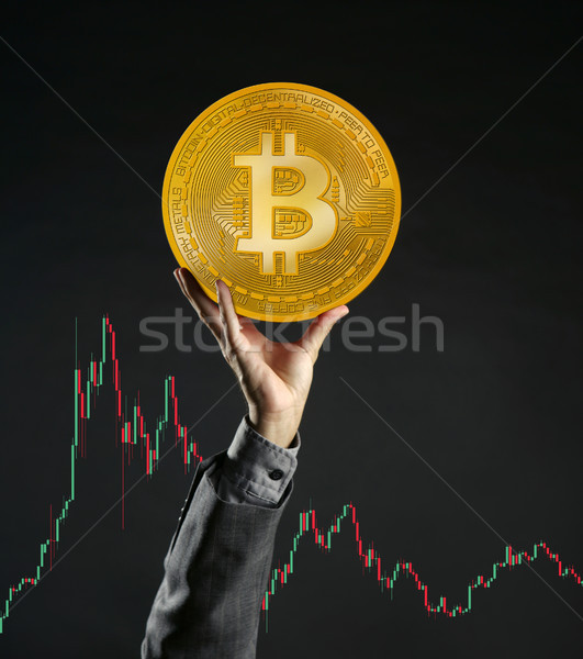 Businessman rising up Bitcoin currency coin Stock photo © lunamarina