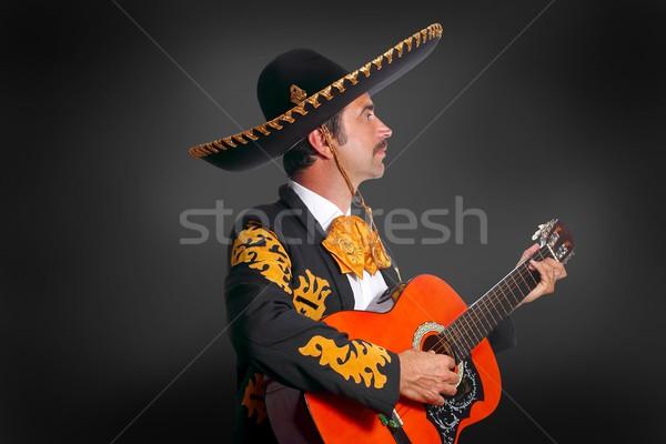 Charro Mariachi playing guitar on black Stock photo © lunamarina