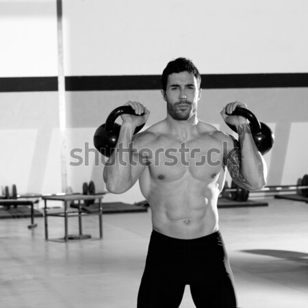 Crossfit man lifting kettlebell workout exercise Stock photo © lunamarina