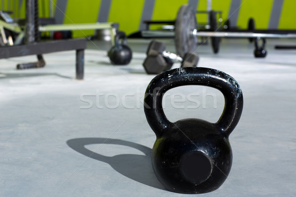 Kettlebell at crossfit gym with lifting bars Stock photo © lunamarina