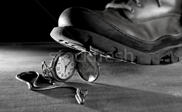 old boot treading a vintage pocket watch Stock photo © lunamarina