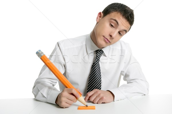 Young businessman student thinking with pencil Stock photo © lunamarina