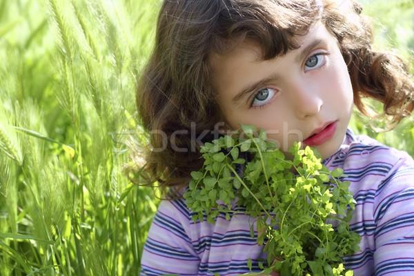 little girl hug green plant meadow spikes Stock photo © lunamarina