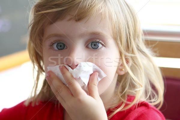 Little blond girl tissue in nose Stock photo © lunamarina