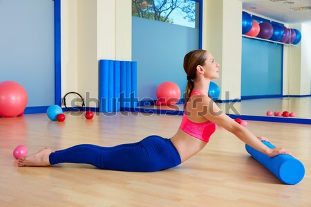 Pilates woman teaser exercise workout at gym Stock photo © lunamarina