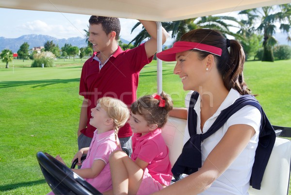 Stock photo: golf course family father mother daughters buggy