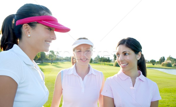 Golf three woman in a row green grass course Stock photo © lunamarina