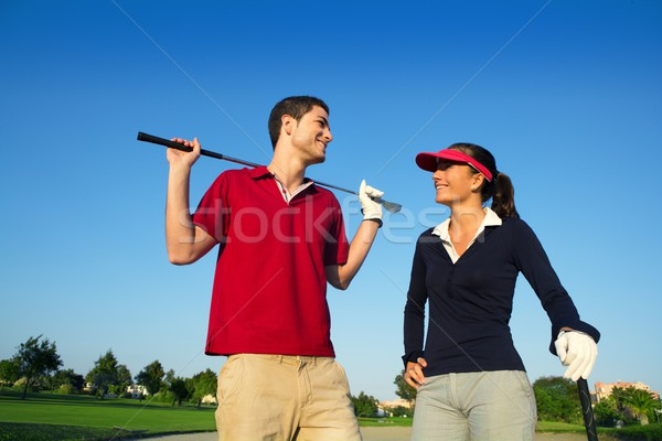 Golf course young happy couple players couple talking Stock photo © lunamarina