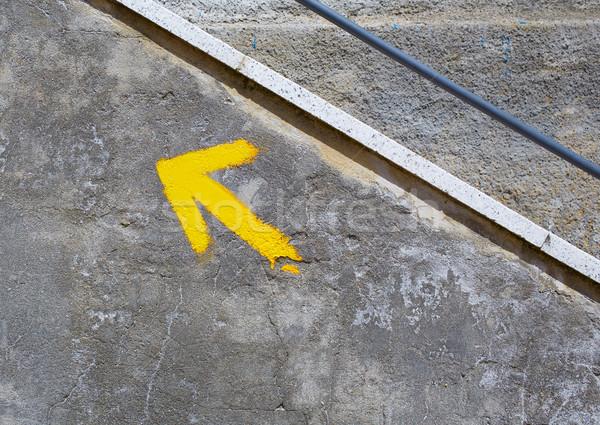 Yellow arrow sign in The Way of Saint James Stock photo © lunamarina