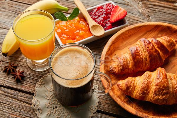 Continentaal ontbijt croissant koffie sinaasappelsap ontbijt continentaal Stockfoto © lunamarina