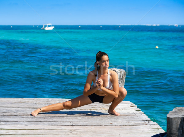 Stock photo: Latin athlete woman stretching in Caribbean