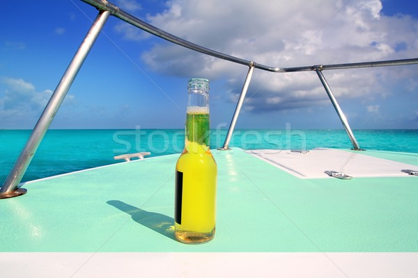 beer on Caribbean boat bow deck turquoise sea Stock photo © lunamarina