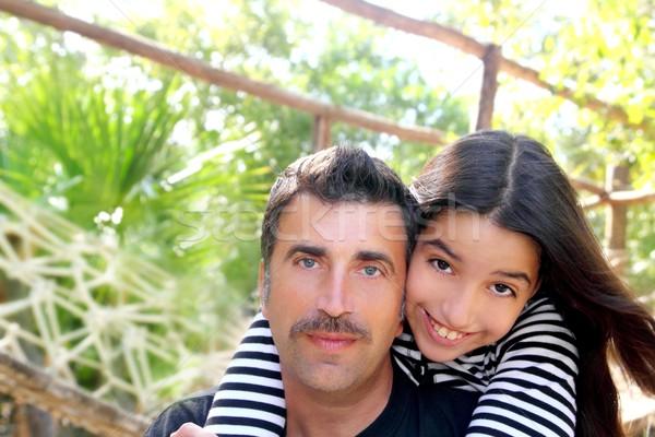 Hispanic latin father and teen daughter hug park Stock photo © lunamarina