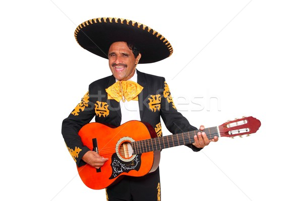 Charro mexican Mariachi playing guitar on white Stock photo © lunamarina