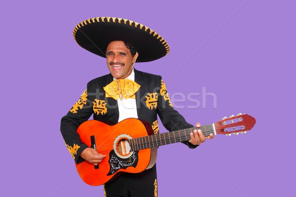 Charro Mariachi singing playing guitar on purple Stock photo © lunamarina