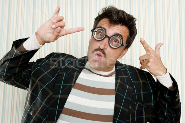 nerd silly crazy myopic glasses man funny gesture Stock photo © lunamarina
