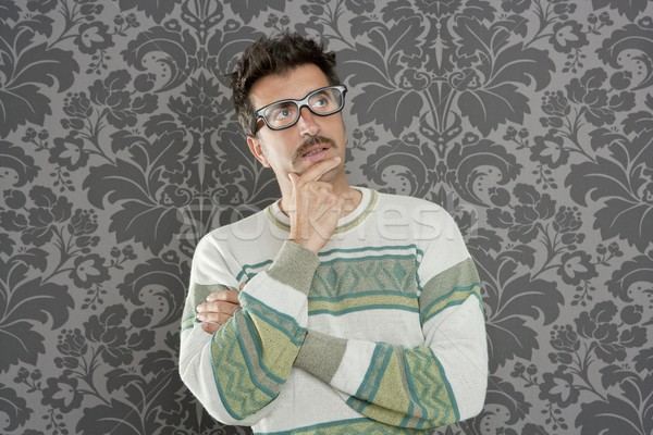 nerd pensive silly man retro wallpaper glasses tacky Stock photo © lunamarina