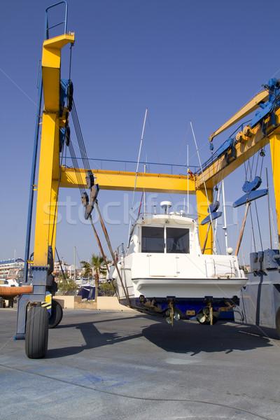 Barco guindaste lancha amarelo Foto stock © lunamarina