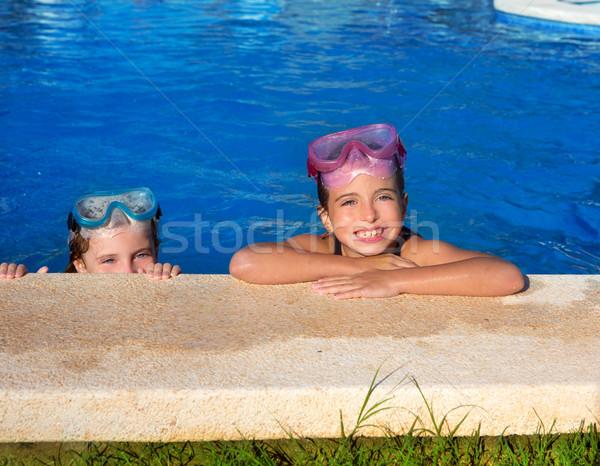 Blue eyes children girls on on blue pool poolside smiling Stock photo © lunamarina