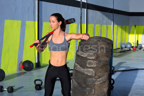 Crossfit sledge hammer woman at gym relaxed Stock photo © lunamarina