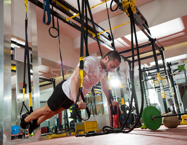 Crossfit fitness TRX push ups man workout Stock photo © lunamarina