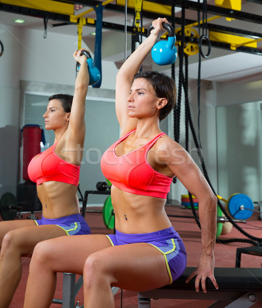 Crossfit fitness weight lifting Kettlebell woman at mirror Stock photo © lunamarina