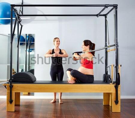 Terhes nő pilates előre lökés testmozgás edzés Stock fotó © lunamarina