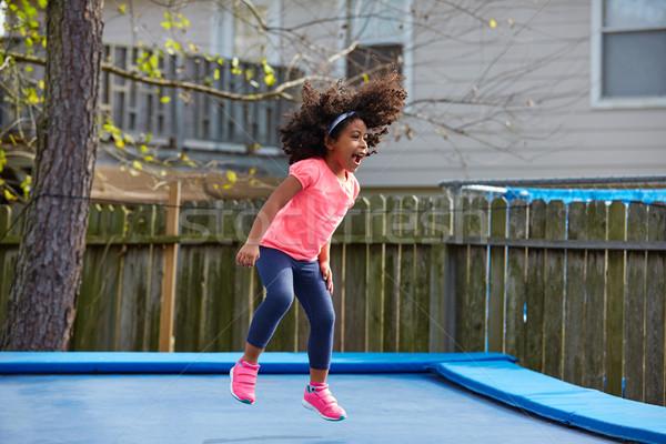 Criança criança menina saltando trampolim recreio Foto stock © lunamarina
