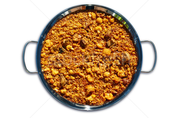 Cauliflower and pork ribs Paella on white Stock photo © lunamarina