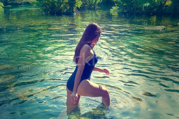 Beautiful teen girl in cenote of Riviera Maya Stock photo © lunamarina