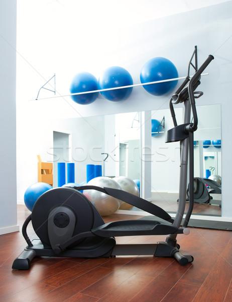 Aerobics cardio training elliptic crosstrainer at gym Stock photo © lunamarina