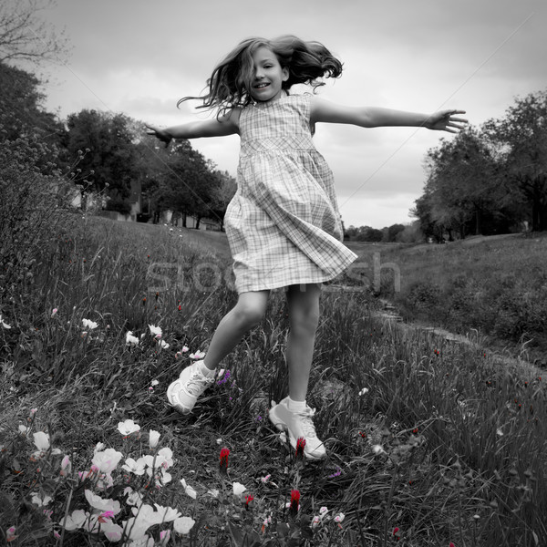happy children girl jumping on spring poppy flowers Stock photo © lunamarina